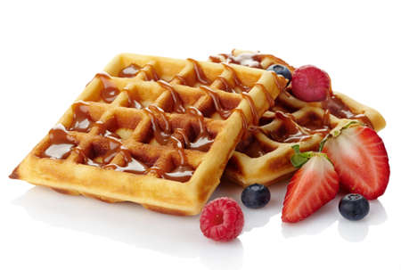 Photo for Belgium waffles with caramel sauce and fresh berries isolated on white  - Royalty Free Image