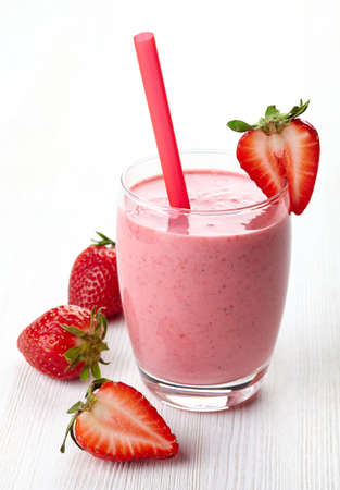 Photo for Glass of strawberry smoothie and fresh strawberries - Royalty Free Image