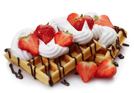 Photo for Belgian waffles with whipped cream, strawberries and chocolate sauce isolated on white background - Royalty Free Image