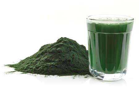 Photo pour Stack of spirulina algae powder and spirulina drink isolated on white background - image libre de droit