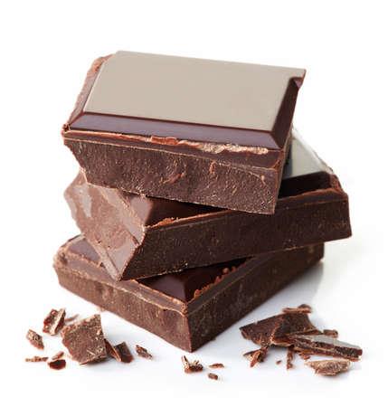 Foto de Stack of dark chocolate isolated on white background - Imagen libre de derechos