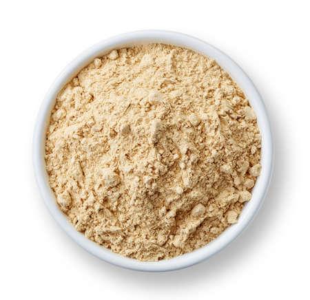 Photo for White bowl of maca powder isolated on white background - Royalty Free Image