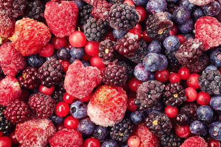 Foto de Close up of frozen mixed fruit - berries - red currant, raspberry, strawberry, blackberry, blueberry - Imagen libre de derechos