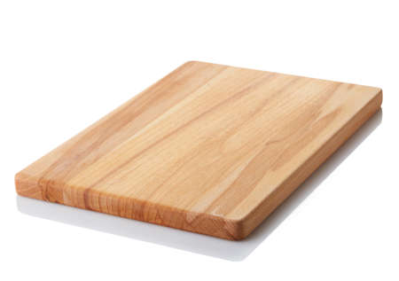 Foto de Brown wooden cutting board isolated on white background. Clipping path - Imagen libre de derechos