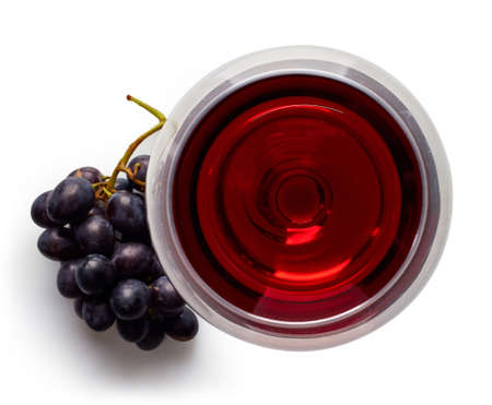 Photo pour Glass of red wine and grapes isolated on white background from top view - image libre de droit