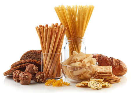 Foto de Gluten free food. Various pasta, bread and snacks isolated on white background. - Imagen libre de derechos