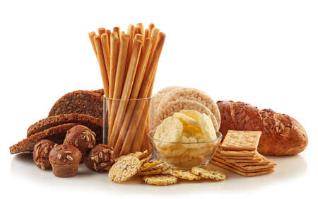 Foto de Gluten free food. Various snacks and bread isolated on white background. - Imagen libre de derechos