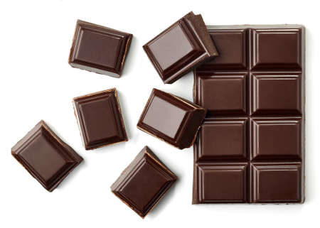 Foto de Dark chocolate pieces isolated on white background from top view - Imagen libre de derechos