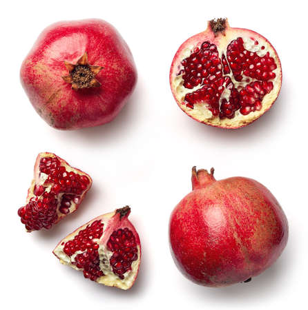Foto de Fresh whole and half of pomegranate isolated on white background from top view - Imagen libre de derechos