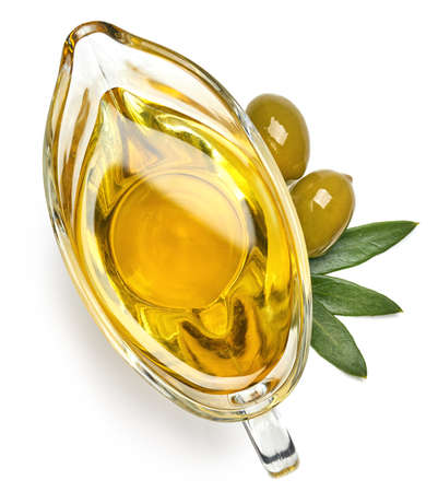 Photo pour Glass gravy boat of fresh extra virgin olive oil isolated on white background. Top view - image libre de droit
