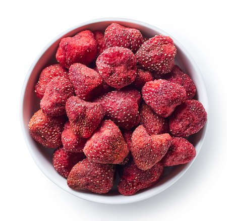 Photo for Bowl of freeze dried strawberries isolated on white background. Top view - Royalty Free Image