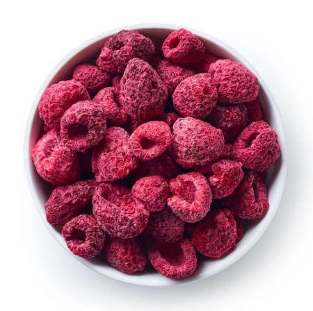 Foto de Bowl of freeze dried raspberries isolated on white background. Top view - Imagen libre de derechos
