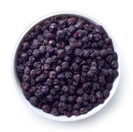 Foto de Bowl of freeze dried blueberries isolated on white background. Top view - Imagen libre de derechos