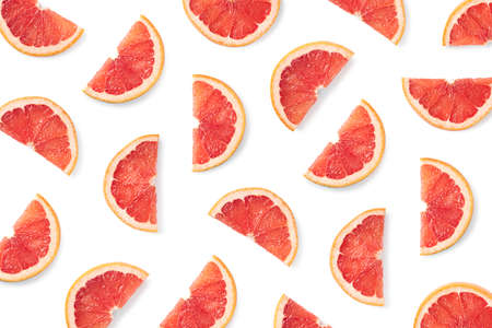 Photo for Fruit pattern of grapefruit slices isolated on white background. Top view. Flat lay - Royalty Free Image
