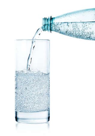 Photo for Pouring sparkling water in a glass isolated on white background - Royalty Free Image