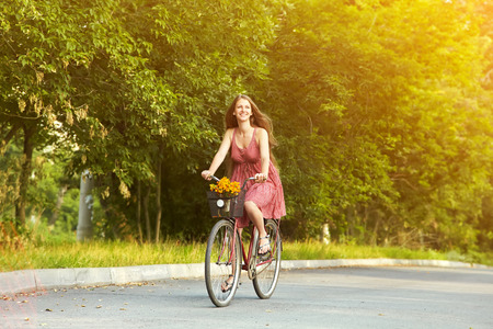 Photo for young beautiful woman riding a bicycle in a park. Active people. Outdoors - Royalty Free Image