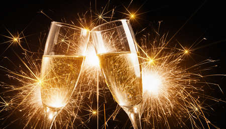 Photo pour Glasses of champagne and sparklers on bright background with sparklers - image libre de droit