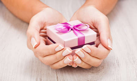 Photo for Small gift in female hands close up - Royalty Free Image