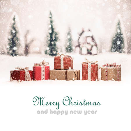 Foto de Christmas landscape with gifts and snow. Christmas background - Imagen libre de derechos