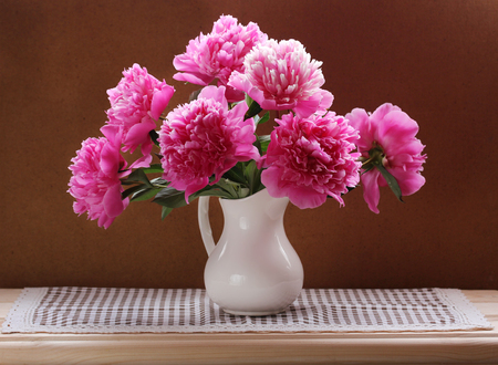 Photo for Still life with a bouquet of pink peonies. Flowers from the garden in a white jug. - Royalty Free Image