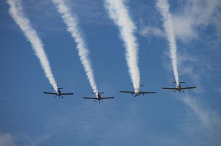 Foto de Smoke comes out of planes flying over an event in New Bern North Carolina - Imagen libre de derechos
