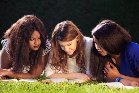 Photo pour Close up of three young girls studying for exams - image libre de droit