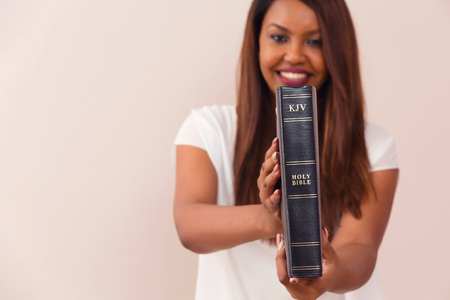 Foto de Happy Girl Proudly Showing Her King James Bible - Imagen libre de derechos