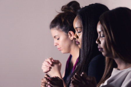 Photo for Three Dedicated Christian Ladies Praying To God - Royalty Free Image