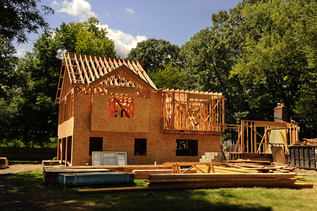 Photo pour A residential home under construction mid framing and sheathing - image libre de droit