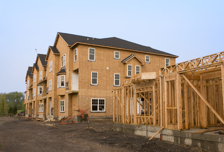 Photo for A housing complex under construction in various stages of development - Royalty Free Image