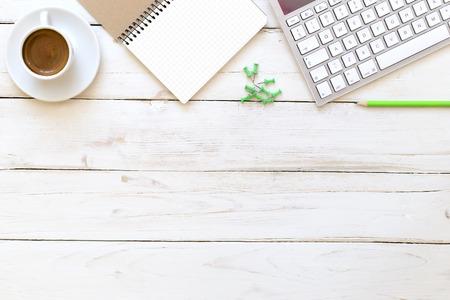 Foto de Office desk with notepad, computer keyboard  and coffee cup. - Imagen libre de derechos