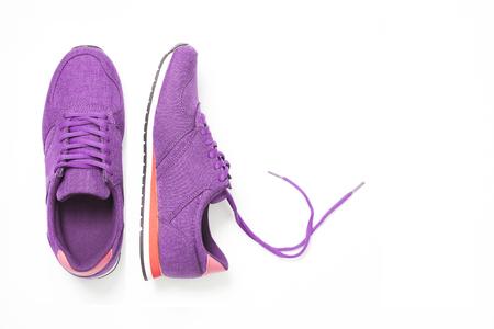 Foto de pair of new purple sneakers isolated on white background. - Imagen libre de derechos