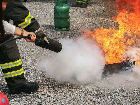 Photo for Firefighters trained how to use fire extinguishers. - Royalty Free Image