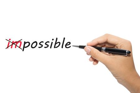 Foto de Business hand writing Change impossible to possible  - Imagen libre de derechos