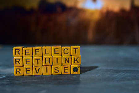 Photo pour Reflect - Rethink - Revise on wooden blocks. Cross processed image with bokeh background - image libre de droit