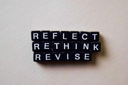 Foto de Reflect - Rethink - Revise on wooden blocks. Business and inspiration concept - Imagen libre de derechos