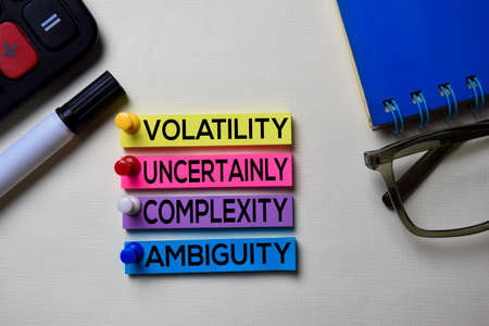 Photo pour Volatility Uncertainly Complexity Ambiguity - VUCA text on sticky notes isolated on office desk - image libre de droit