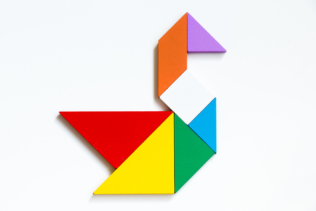 Photo pour Colorful wood tangram puzzle in swan shape on white background - image libre de droit