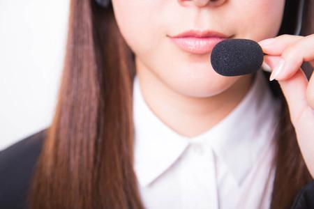 Female customer support phone operator in headset