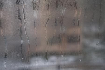 Foto de Close view of a distinctly dirty window showing grit, grime, streaks and opacity. - Imagen libre de derechos