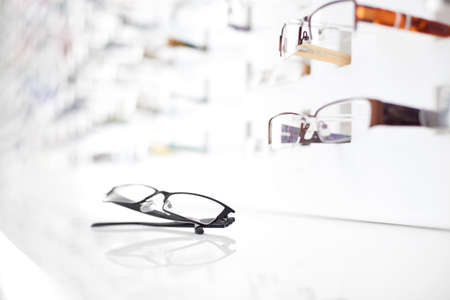 Photo pour Closeup of glasses with many eyeglasses in background - image libre de droit