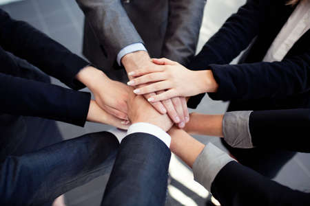 Photo pour Group of business people joining hands. - image libre de droit