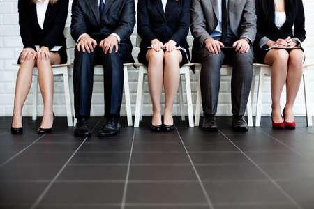 Photo pour Stressful people waiting for job interview - image libre de droit