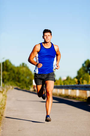Photo for Young man sprinting outdoors. - Royalty Free Image
