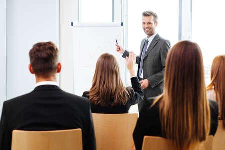 Foto de Businessman giving a presentation on flipchart. Teamwork concept - Imagen libre de derechos