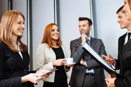 Photo pour Business people talking during conference break; networking - image libre de droit