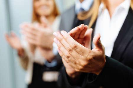Photo pour Close-up of business people clapping hands. Business seminar concept - image libre de droit