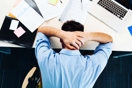 Photo pour Businessman having stress in the office - image libre de droit
