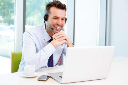 Foto de Businessman during conference with headset - Imagen libre de derechos
