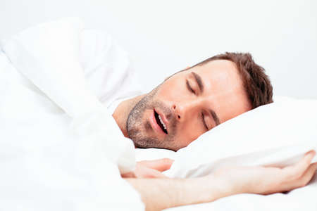 Photo pour Portrait of a man sleeping with an open mouth - image libre de droit
